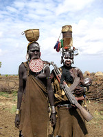Mursi Women Pose with Gun and Child